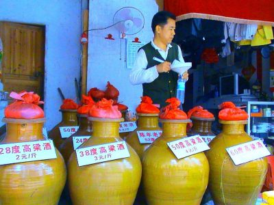Crockery jars of locally-made baijiu in a liquor store in Haikou, Hainan, China, with signs indicating alcoholic content and price per jin (500 grams). Source: Wikipedia
